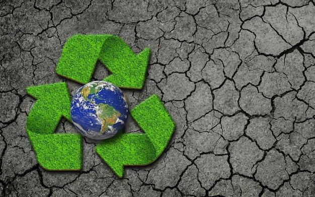 Logotipo globo e reciclagem no chão quebrado