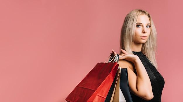 Loiro, comprador, papel levando, sacolas