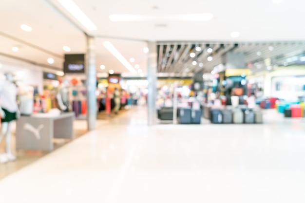 Loja borrão abstrata e loja de varejo em shopping center