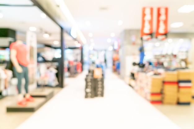 Loja de borrão abstrata e loja de varejo em shopping para mesa