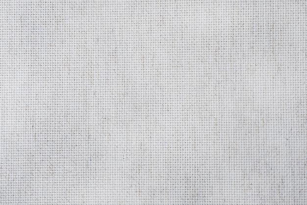 Lona de tecido para artesanato em ponto de cruz. textura de tecido de algodão.
