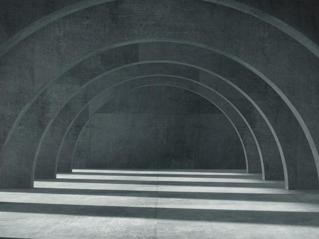 Longo corredor de concreto com luz e sombra.