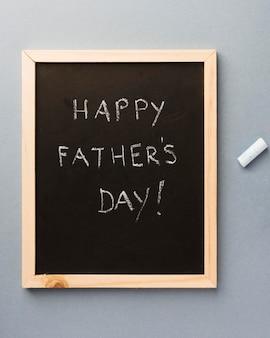 Lousa com mensagem para o pai