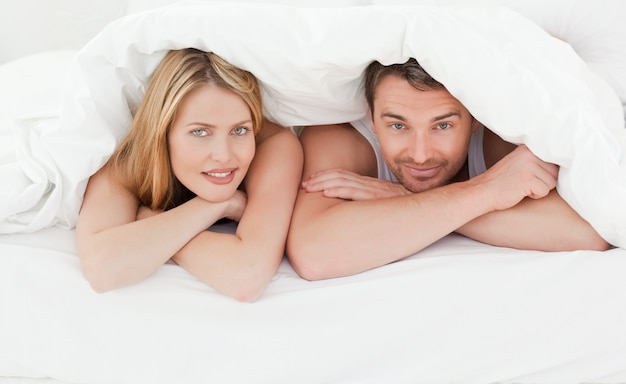 Lovely couple in their bed