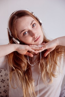 Lovely woman in headphones looking to camera