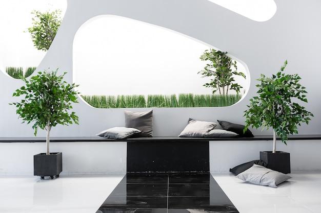 Luxuoso interior moderno, futurista e moderno em cores contrastantes de preto e branco com interessantes móveis pretos modernos e paredes decoradas