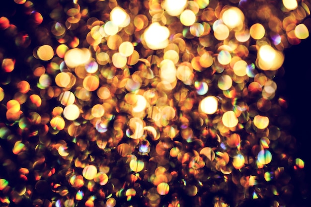 Luz abstrata turva da lâmpada de luxo à noite para fundo de festa ou comemoração