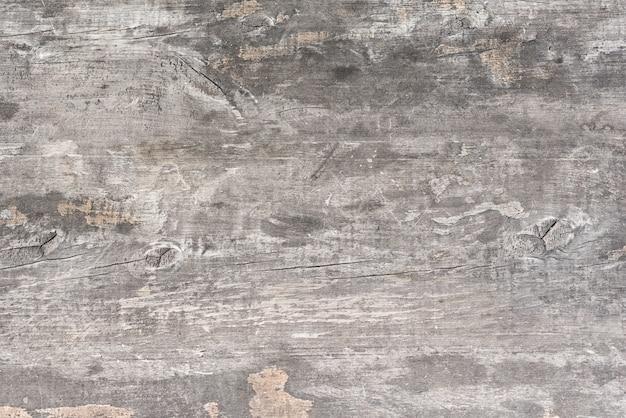 Luz cinza velho texturizado fundo de madeira.