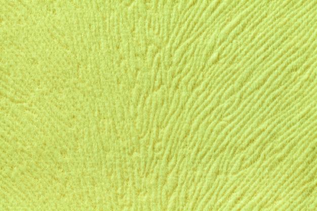 Luz de fundo verde de material têxtil suave. tecido com textura natural.