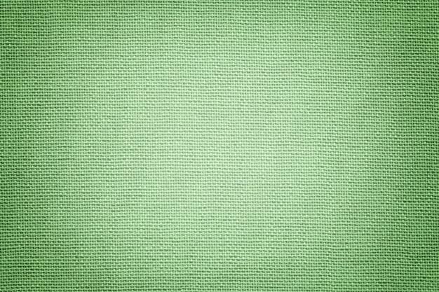 Luz de fundo verde de um material têxtil.