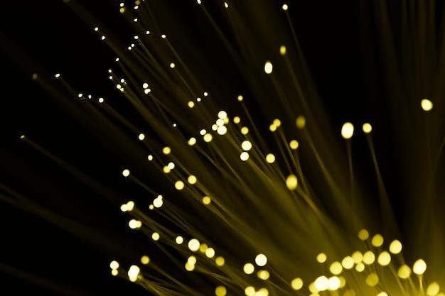 Luz de vidro de fibra amarela abstrata
