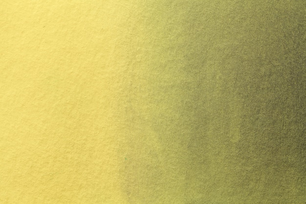 Luz do fundo da arte abstracta - cores amarelas e douradas. pintura em aquarela sobre tela com gradiente de azeitona suave.