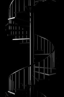 Luz e sombra da escada em espiral na escuridão
