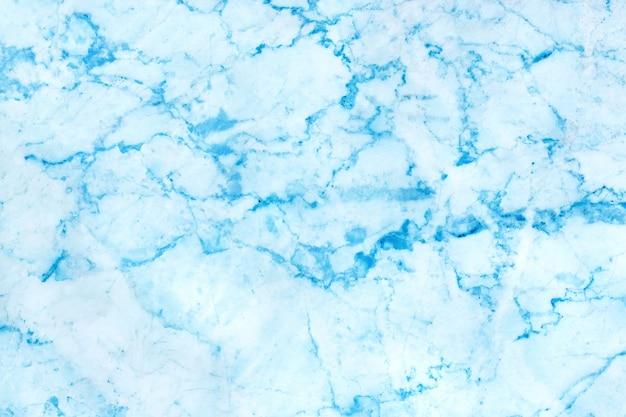 Luz - fundo azul da textura de mármore com o assoalho de pedra da telha da estrutura detalhada brilhante e luxuoso, de telha na superfície natural para o interior ou o exterior.