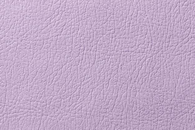 Luz - fundo de couro roxo da textura, close up. pano de fundo rachado lilás
