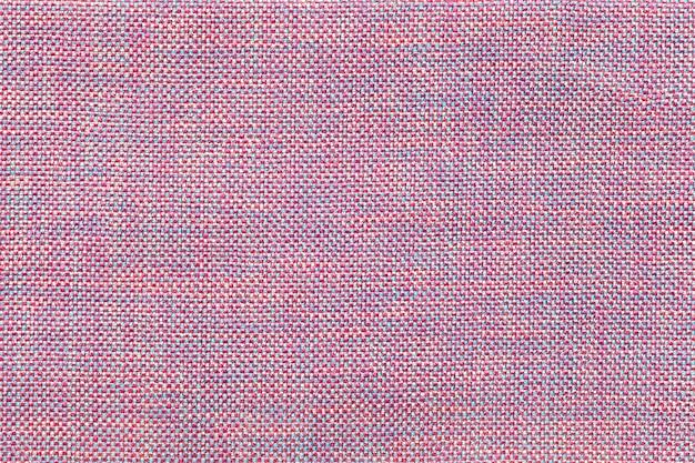 Luz - fundo roxo e azul de matéria têxtil com projeto de xadrez, close up. estrutura da macro de malha.
