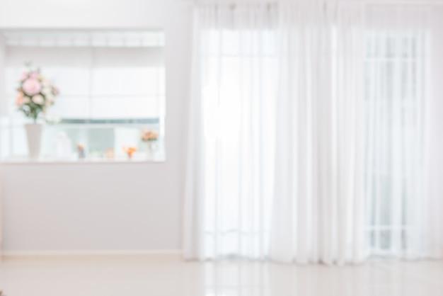 Luz turva da sala da frente da atmosfera de fundo brilhando através da cortina em casa.