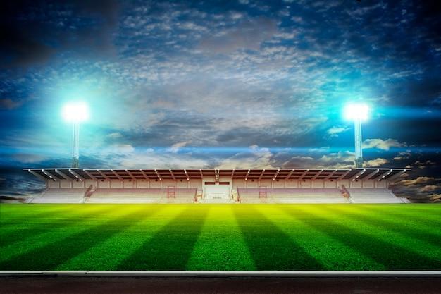 Luzes à noite e renderização em 3d do estádio