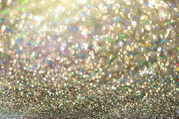 Luzes abstratas do bokeh do ouro e da prata.