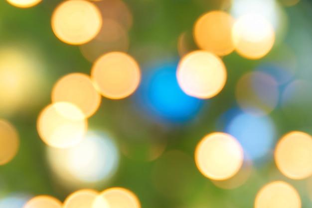 Luzes azuis, amarelas e verdes de férias - fundo suave de natal
