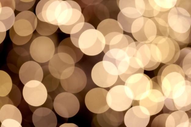 Luzes de bokeh abstrato turvo dourado brilhante