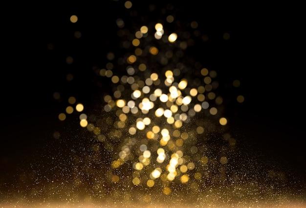 Luzes de brilho de ouro com bokeh de fundo