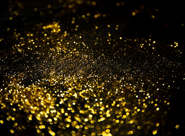 Luzes de brilho de ouro em preto
