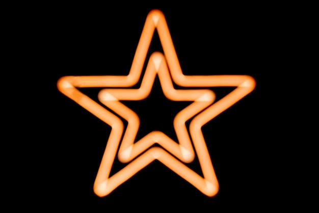 Luzes de néon de estrelas cadastre-se no fundo escuro