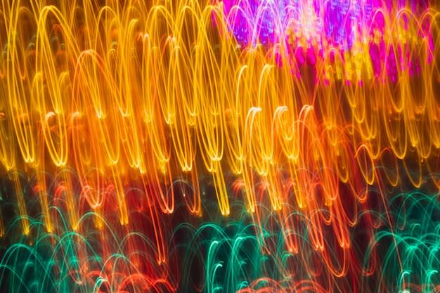 Luzes de néon de fundo iluminado amarelo