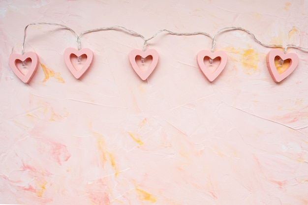 Luzes decorativas em forma de coração em rosa