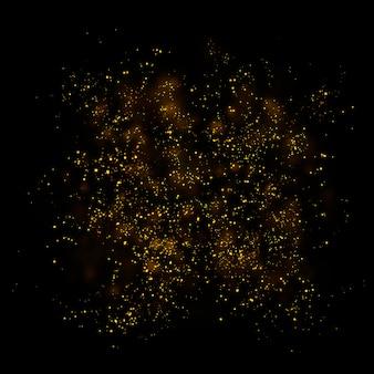 Luzes e bokeh das partículas do brilho do ouro em um fundo preto.