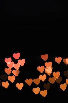Luzes em forma de coração laranja
