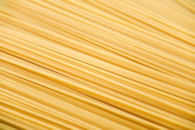 Macarrão italiano espaguete cru espaguete cru espaguete textura de fundo pronto para cozinhar no restaurante comida italiana e menu