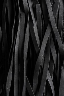 Macarrão preto tagliatelle close-up