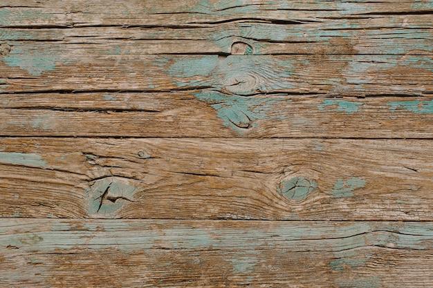Madeira vintage com superfície de tinta turquesa