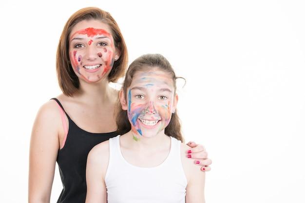 Mãe filha, menina, com, pintar cara, sobre, branca