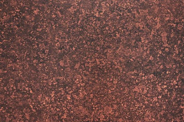 Mancha abstrata vermelha com fundo de textura de papel de cor preta