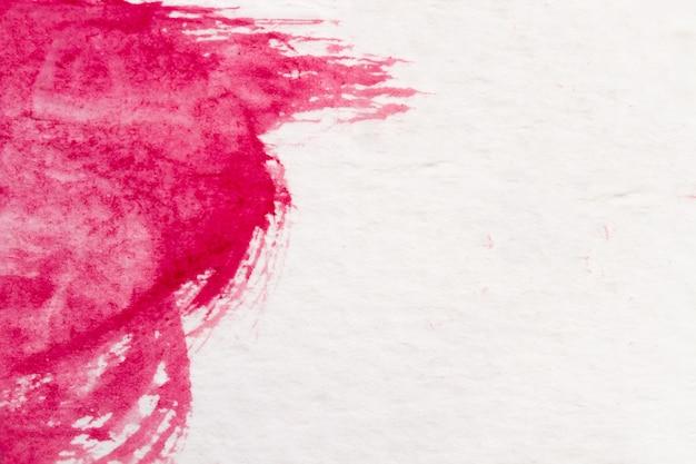 Mancha de aquarela vermelha com lavagem.