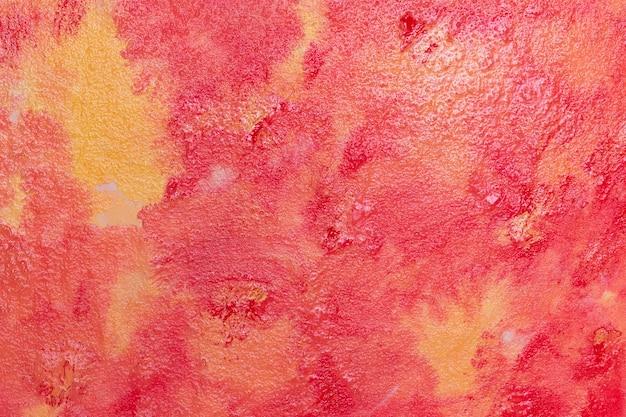 Mancha de pintura vermelha e laranja