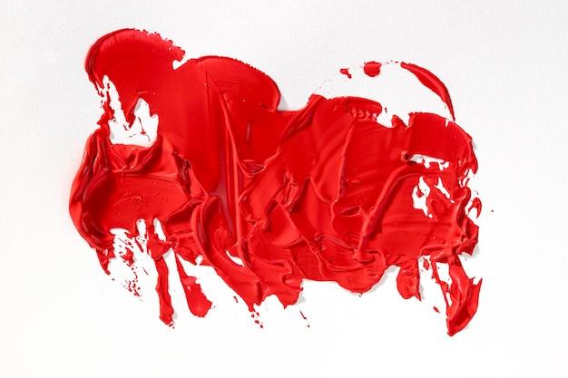 Mancha de tinta vermelha brilhante de arte abstrata