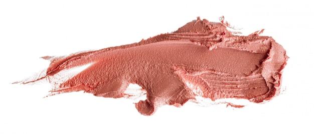 Manchas de um batom rosa isolado no branco