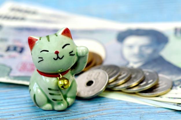 Maneki-neko, o gato sortudo e dinheiro japonês.