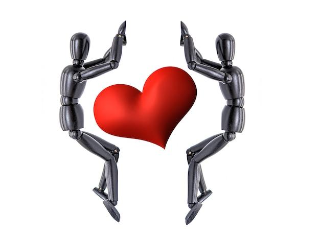 Manequim de madeira dois e coração vermelho