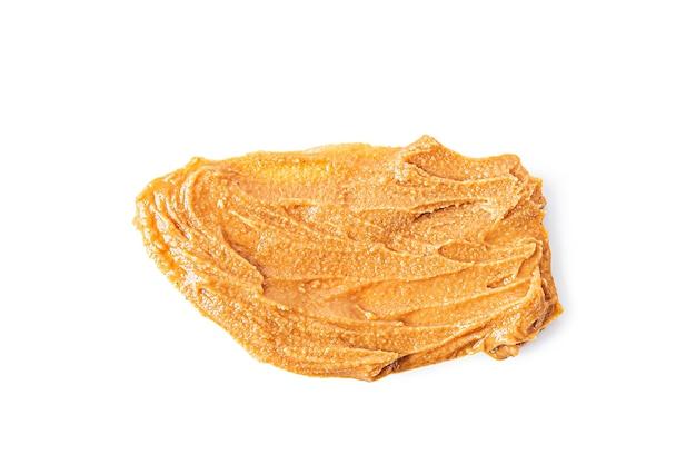 Manteiga cremosa de amendoim caseira ou pasta isolada