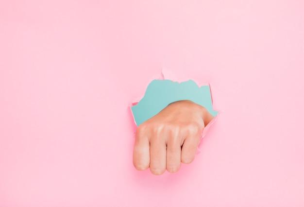 Mão, através, papel, buraco