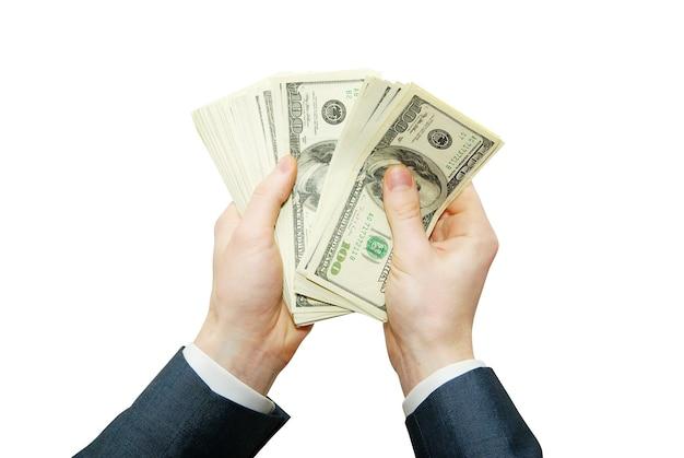 Mão com dinheiro isolado no fundo branco