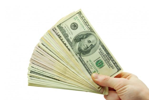 Mão com fã do dólar