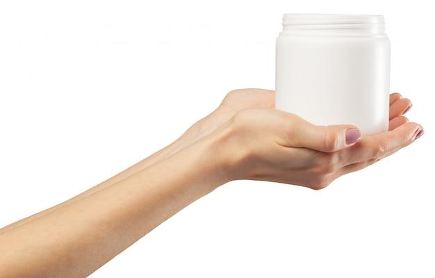 Mão com um frasco de cosmético