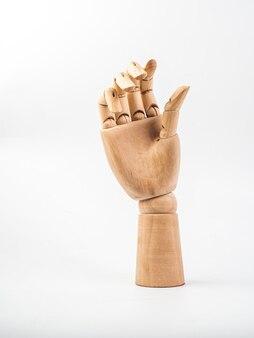 Mão de boneca de madeira em bakground branco