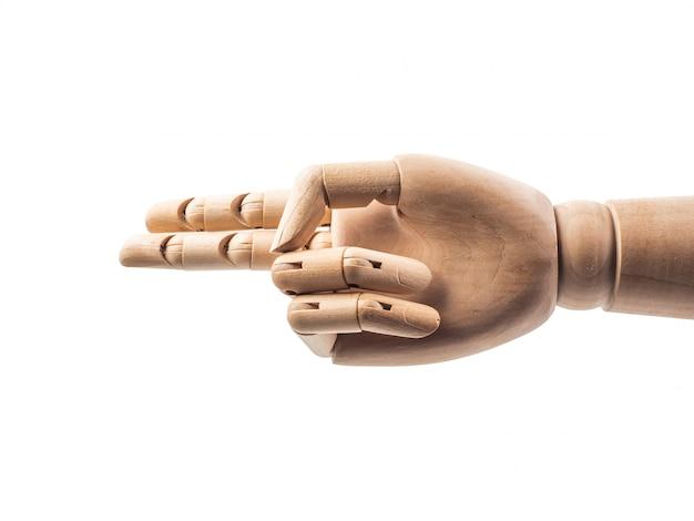 Mão de boneca de madeira faz dedos para tocar em branco